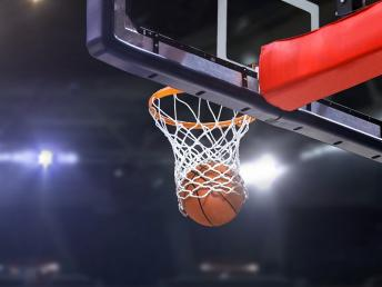 Basketball going through the rim and net
