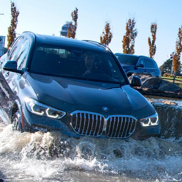 BMW SUV treading water on the course